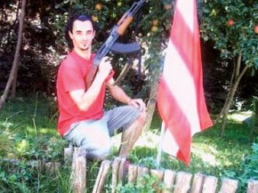 the Romanian folk singer with his gun & funderland flag