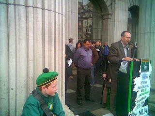 A young band member, Fergal Moore and Des Dalton, pictured at the GPO in Dublin on Easter Monday 2014.