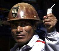 a bolivian miner. with stick of dynamite. photographed after Mr Morales asked them to stop.