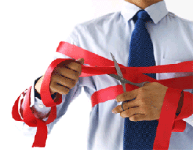 Person caught up in red tape and attempting to cut through it