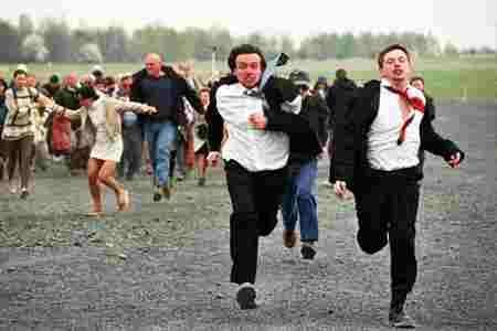 The two lads running from the crowd...
