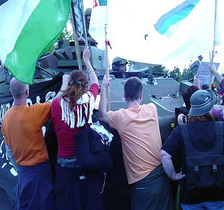 Protestors halt tank