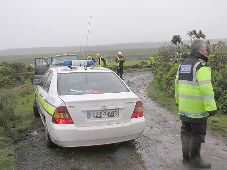 The Gardai on the scene, transporting Mary Corduff to the doctor in Belmullet, some 20 miles away