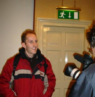 Resisting The Urge To Make A Speedy Exit, Damien Gets Interviewed For Radio Indymedia