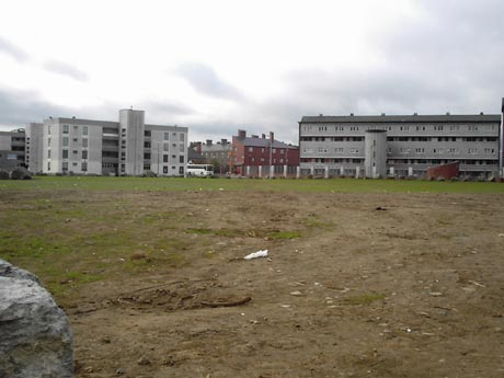Empty space where new houses were supposed to be built (good spot for a community garden action?)