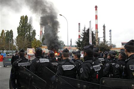 French riot police have forcibly cleared access to the main refinery supplying fuel to Paris