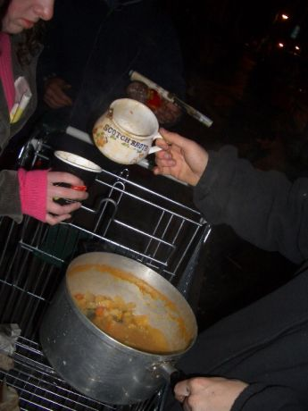 grassroots support - food not bombs give out soup