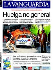 Spains papers front page shows fotos of CITY IN FLAMES
