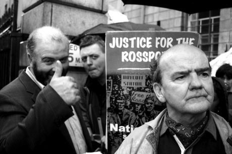 Willie Corduff gives the thumbs up as Micheál Ó Seighin speaks to reporters following their release from prison on Sept 30, 2005