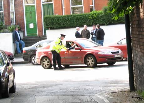Gardai turn cars away as secret police look on