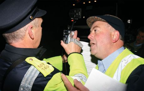 Willie Corduff appeals to a Gardawho is filming at the daily pre-dawn protest close to Shell's proposed gas refinery at Bellanaboy, Co Mayo, October 2006