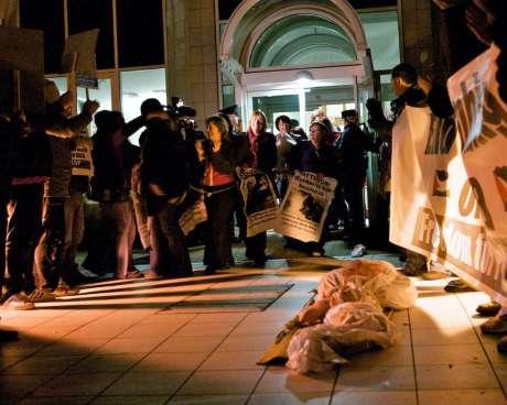 Women anti-war activists outside Raytheon in Derry