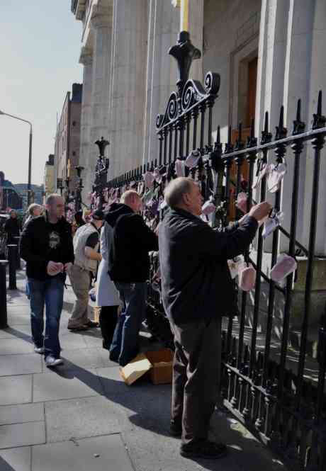 Protesters tying shoes to railings at the Pro Cathedral
