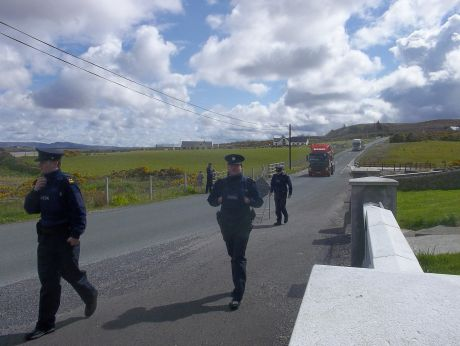 Along this once-quiet road, you can't sit waiting for your lift without being harassed by garda�
