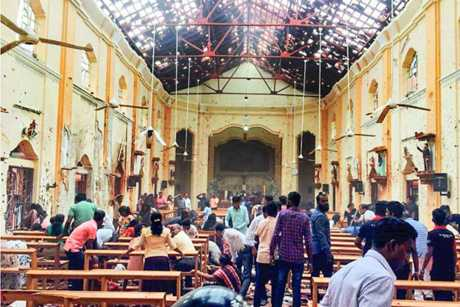 People recovering bodies in Katuwapitiya Church