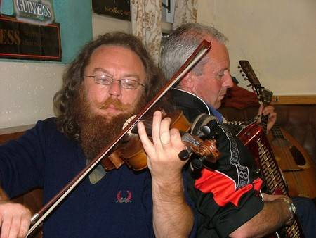 Máirtín and Seán Harrington, Maura's brothers, playing back to back.