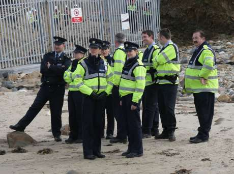 Garda� look on as protesters assert their rights to access the water.
