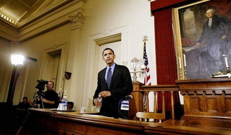 a younger ambitious Obama standing as a Senator in a Senate House Committee room he wasn't a member of.