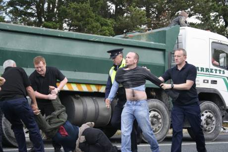 Dublin MEP Paul Murphy being dragged away
