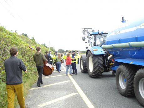 The band continue to play as the tractor moves