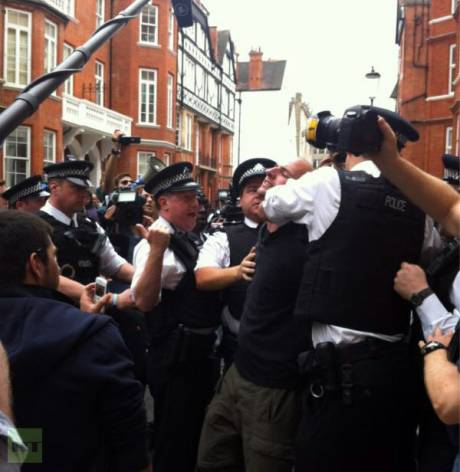 Police Assault Assange Supporters.