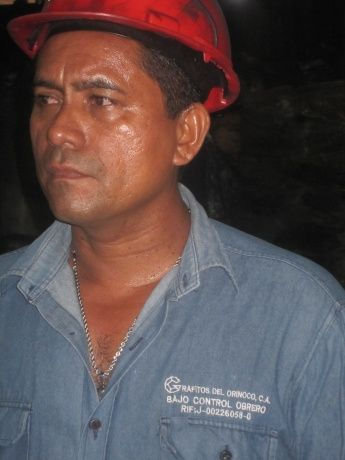 A Grafitos worker, April 2011. His overall reads, �Grafitos del Orinoco: Under Worker Control�. (Ewan Robertson)
