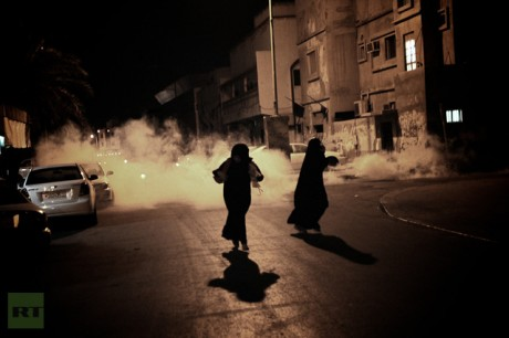 Bahraini women run from tear gas fired by police during an anti-government demonstration in the village of Bani Jamrah, West of Manama, on August 2, 2012 (AFP Photo / Mohammed Al-Shaikh)