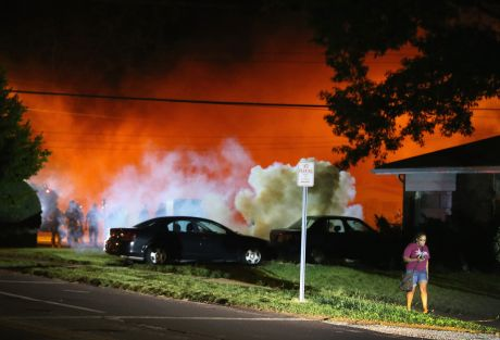 "Wreathed in smoke and tear gas like a military ""warzone"". But this is just the US town of Ferguson"