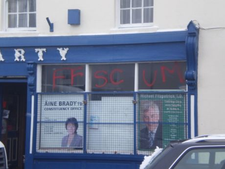 Aine Brad�s constituency office in Cellbridge sprayed with �FF SCUM� on front window.