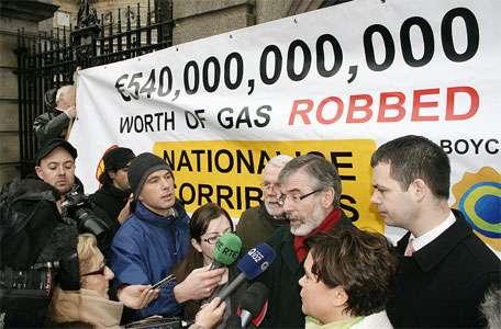 Gerry Adams speaks to a large media scrum