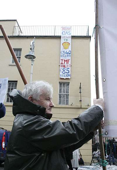 Banner dropped from roof of Buswells Hotel