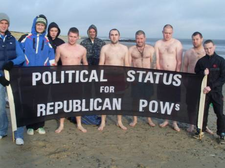 CABHAIR Swim , Wexford - 25/12/2011 . Five swimmers seek shelter behind a banner.....!