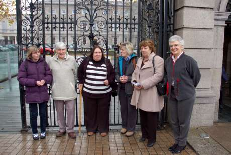 The family with TDs Catherine Murphy and Katherine Zappone before a meeting at the D�il