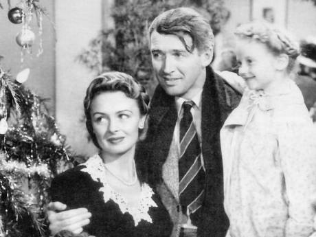 George Bailey (James Stewart), Mary Bailey (Donna Reed), and their youngest daughter Zuzu (Karolyn Grimes) in It's a Wonderful Life.