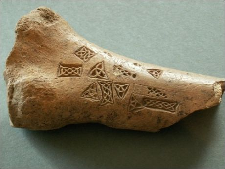 Bone motif piece from Roestown