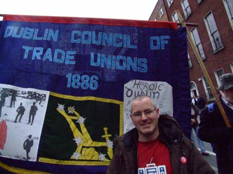DCTU banner with added smiling protestor