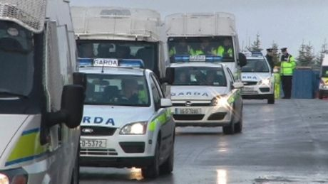 Garda Vehicles follow protesters to main gate