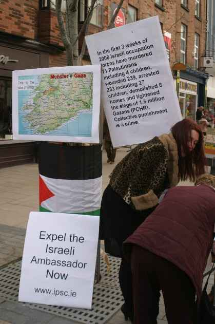 IPSC Stall showing map of Gaza V Munster and the number of palestinians murdered, wounded and arrested in the last three weeks.