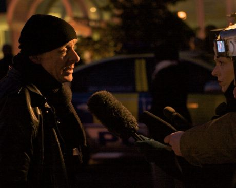 Outside the Raytheon plant in Derry Eamonn McCann talks to the media while nine women remain chained to internal doors blocking access to Raytheon's offices.