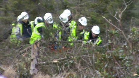 IRMS supervisor getting stretchered out of the woods.  Despite all of Shell's glossy brochures about worker safety, in reality they are totally reckless