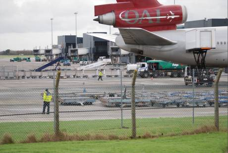 Two Gardai patrolling OMNI Air troop carrier at Shannon 8 Jan 2012