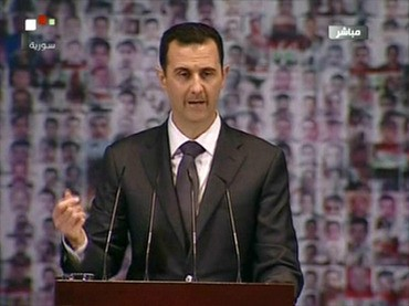 An image grab taken from the state-run Syrian TV shows Syria's embattled President Bashar al-Assad making a public address on the latest developments in the country and the region on January 6, 2013 (AFP Photo)