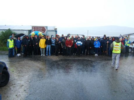 damp walkers pose outside Shell's compound in Rossport this morning