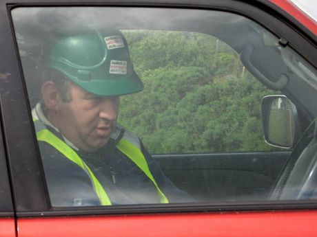 A shell contractor with a radio observed the protests from a jeep protected by Gardaí