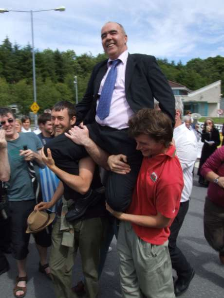 Pat being chaired away from prison