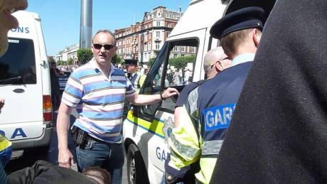 The guard from Store Street Garda Station who arrested me (with sunglasses). Does anybody know who he is?