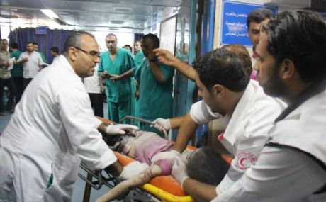 Child wounded in attack on Al-Rimal neighborhood, July 20th (image by Palestinian Ministry of Health)
