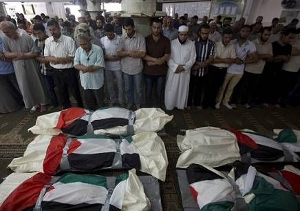 The bodies of those killed in the shelling of a hospital which is a war crime. Image By Arabs48