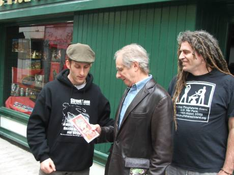 Damien presenting Ken Loach with Peace On Trial DVD - Not quite up to Ken's standards!