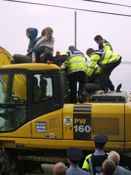 Gardai attempt to remove protesters from the digger.